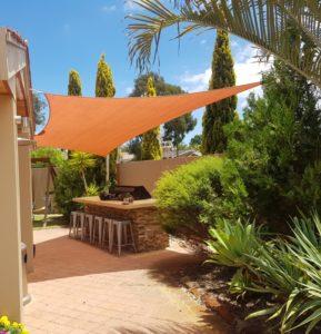 A custom-made shade sail for the backyard.